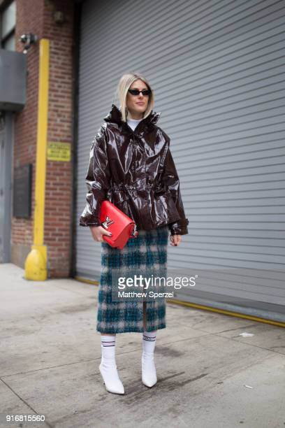 Sofie Valkiers is seen on the street attending SelfPortrait during New York Fashion Week wearing a dark maroon vinyl coat with green plaid skirt and...