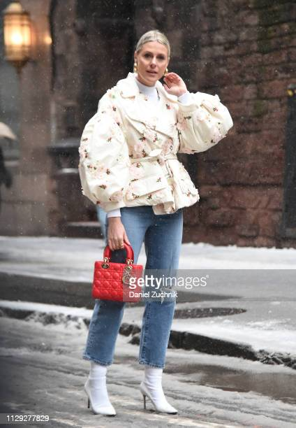 Sofie Valkiers is seen wearing a white floral coat and red bag outside the Coach 1941 show during New York Fashion Week: Fall/Winter 2019 on February...