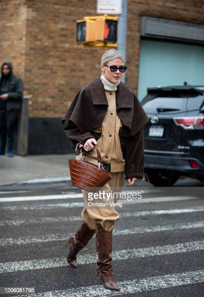 Sofie Valkiers is seen wearing beige jacket and pants brown jacket and bag boots with snake print outside Gabriela Hearst during New York Fashion...