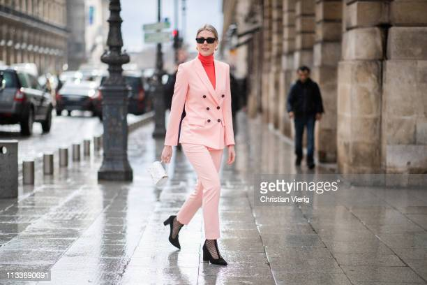 Sofie Valkiers is seen wearing total look Marc Cain including pink suit red turtleneck white mini bag black shoes during Paris Fashion Week...