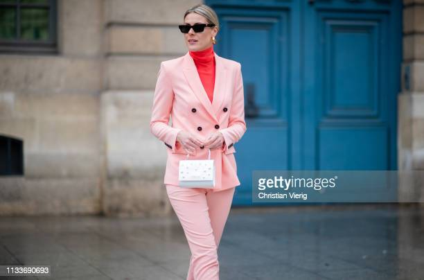 Sofie Valkiers is seen wearing total look Marc Cain including pink suit red turtleneck white mini bag during Paris Fashion Week Womenswear...