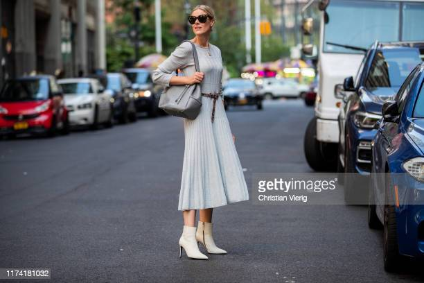 Sofie Valkiers is seen wearing total look Marc Cain: light blue pleated dress, belt, bag, ankle boots during New York Fashion Week September 2019 on...
