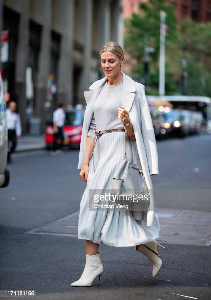 Sofie Valkiers is seen wearing total look Marc Cain: light blue pleated dress and wool coat, belt, bag, ankle boots during New York Fashion Week...