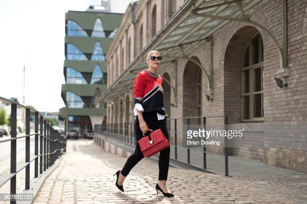 Sofie Valkiers poses at the Marc Cain street style shooting during MercedesBenz Fashion Week Berlin Spring/Summer 2018 on July 4 2017 in Berlin...
