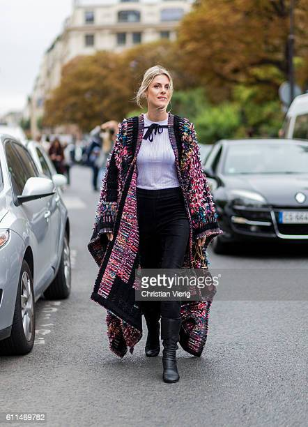 Sofie Valkiers wearing a poncho outside Chloe on September 29, 2016 in Paris, France.