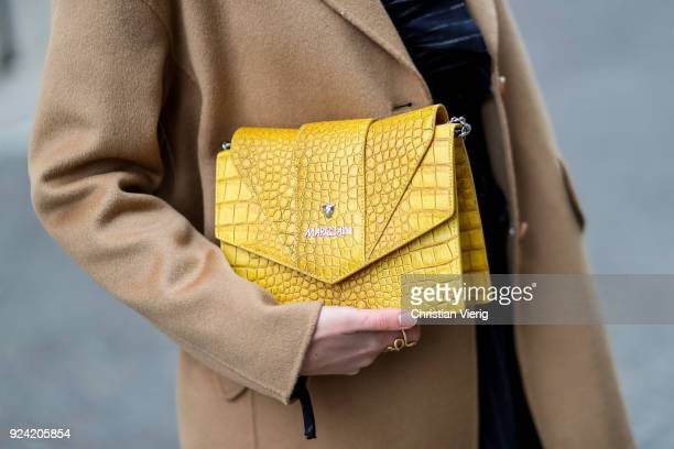 Sofie Valkiers wearing total look Marc Cain including striped dress wool coat yellow bag is seen during Milan Fashion Week Fall/Winter 2018/19 on...