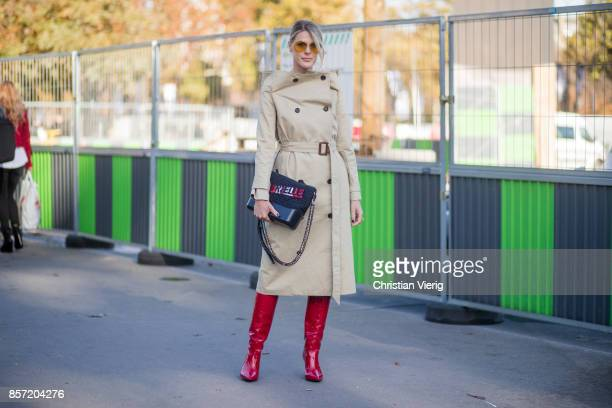 Sofie Valkiers wearing trench coat, bag, red boots seen outside Chanel during Paris Fashion Week Spring/Summer 2018 on October 3, 2017 in Paris,...