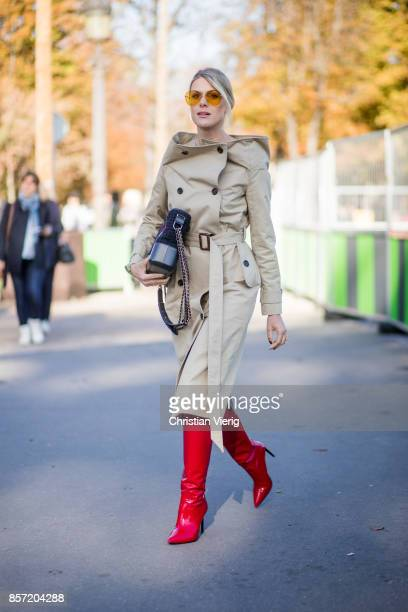 Sofie Valkiers wearing trench coat bag red boots seen outside Chanel during Paris Fashion Week Spring/Summer 2018 on October 3 2017 in Paris France