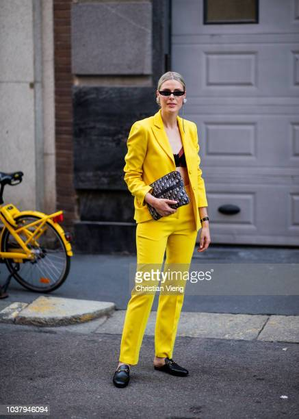 Sofie Valkiers wearing yellow suit is seen outside Blumarine during Milan Fashion Week Spring/Summer 2019 on September 21 2018 in Milan Italy