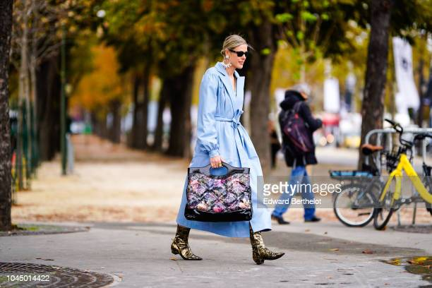 Sofie Valkiers wears a blue dress coat a Chanel bag outside Chanel during Paris Fashion Week Womenswear Spring/Summer 2019 on October 2 2018 in Paris...