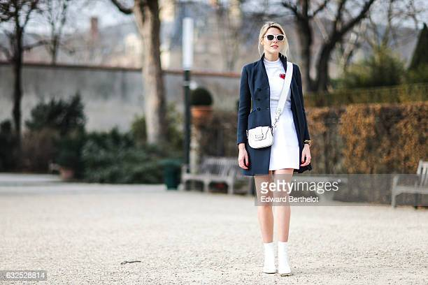 Sofie Valkiers wears sunglasses a long jacket a white dress a white bag white shoes and attends the Christian Dior Haute Couture Spring Summer 2017...