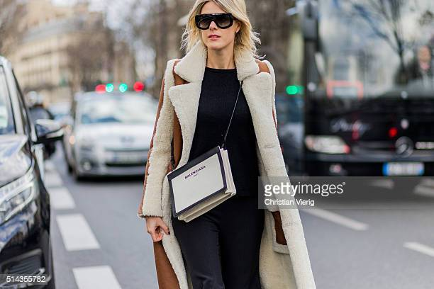 Sofie Valkies is wearing a shearling fur coat from Enes Alexia Ulibarri pants and a white Balencaiga bag outside Ellery during the Paris Fashion Week...