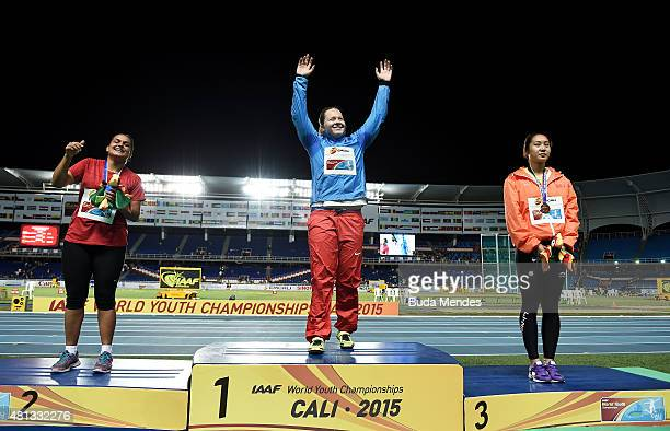 Sofiya Palkina of Russia gold medal Deniz Yaylaci of Turkey silver medal and Ningyu Shang of China bronze medal celebrate on the podium after the...