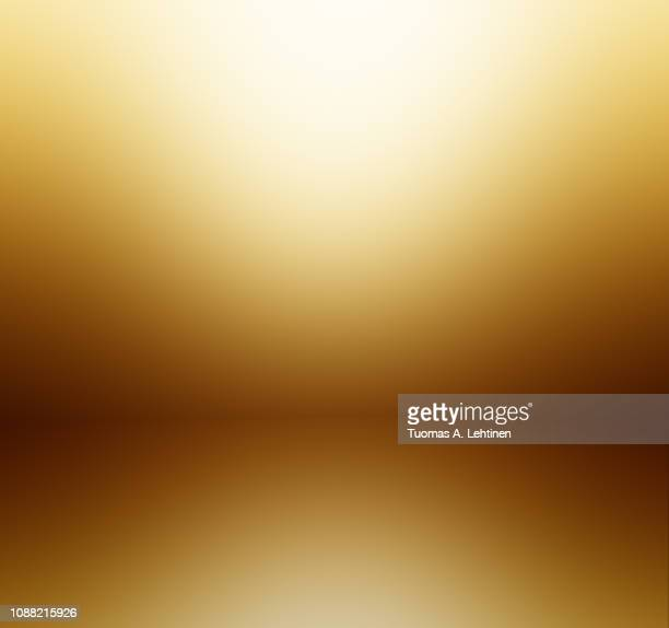 soft and blurred gold and orange colored abstract gradient background with reflection. - marrone foto e immagini stock