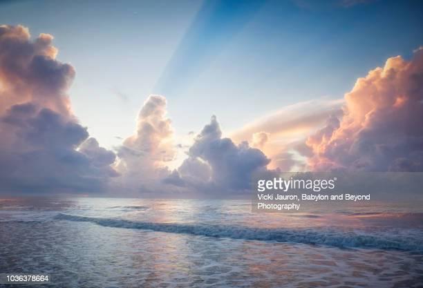 foamy water in dreamlike sunrise at myrtle beach south carolina