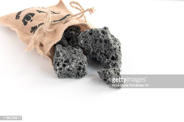 soft coal pieces on jute sack over white background. typical spanish candy of three wise men day. copy space. - la befana photos et images de collection