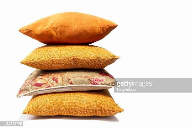 soft colorful pillows on white background. - heap stock pictures, royalty-free photos & images