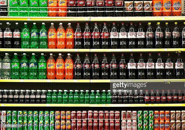 Soft drinks are displayed on the shelf at a Dollar General Corp store in Saddle Brook New Jersey US on Saturday Dec 3 2011 Dollar General is...