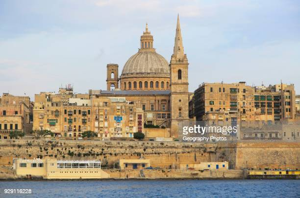 Soft evening light on buildings and churches Valletta, Malta, dome Basilica of Our Lady of Mount Carmel church.