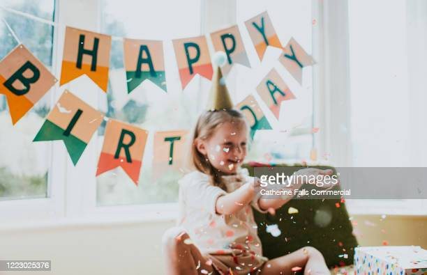 soft focus birthday girl - birthday candle stock pictures, royalty-free photos & images