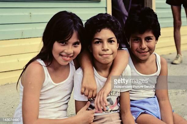Soft focus portrait of three children Costa Rica