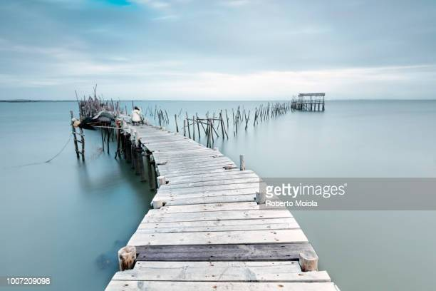 Soft light of dawn on the Palafito Pier, Carrasqueira Natural Reserve of Sado River, Alcacer do Sal, Setubal, Portugal, Europe
