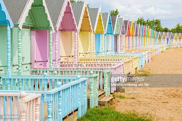Soft pastel colored beach huts in West Mersea, Mersea Island, Essex, England