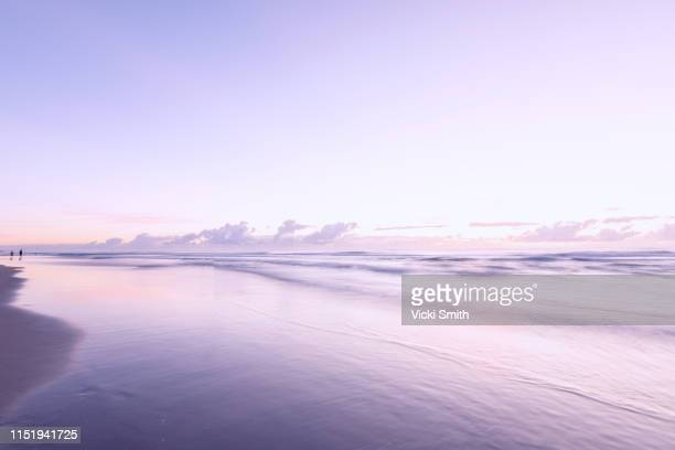 soft pastel colored sunrise over the ocean - morning stock pictures, royalty-free photos & images