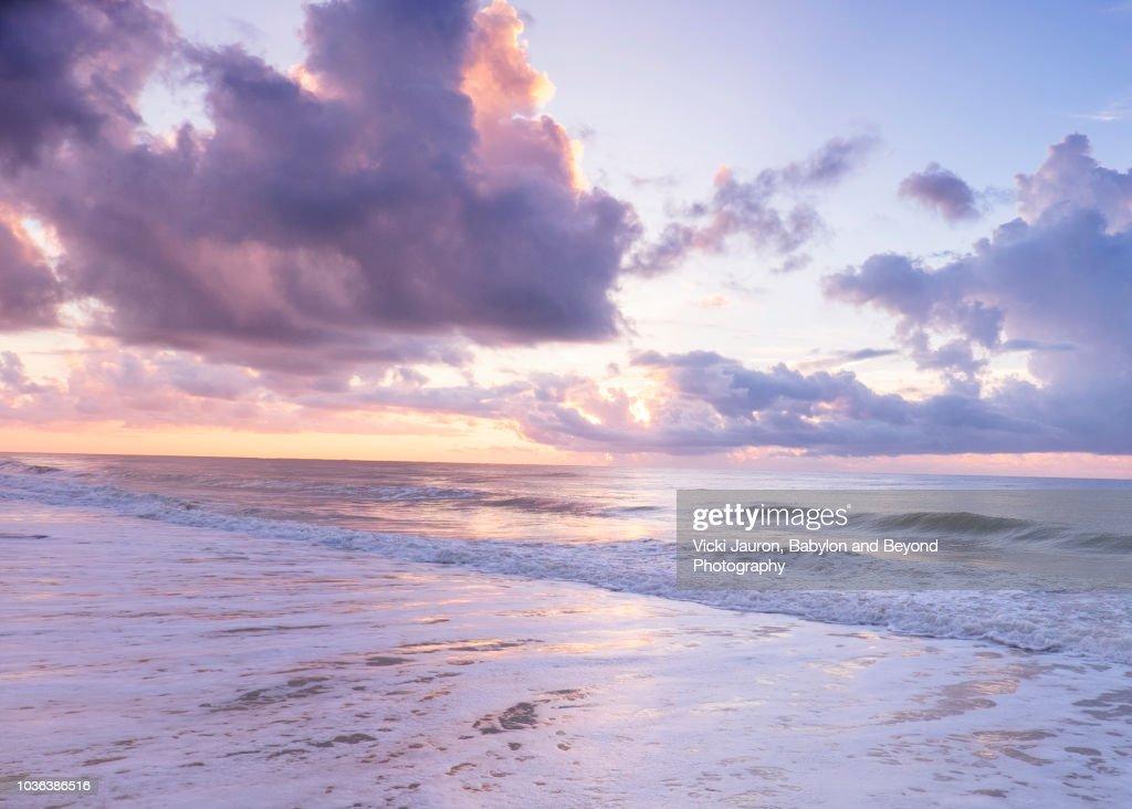 soft pink and purple foam at sunrise on myrtle beach south carolina