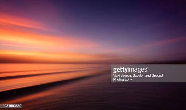 soft pinks and blues at sunset at fort myers beach, florida - gulf coast states photos et images de collection