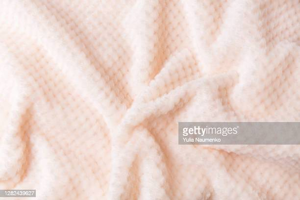 soft plush fleece material with a lot of relief folds. textil background. - blanket stock pictures, royalty-free photos & images