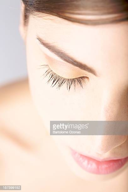Soft portrait of beautiful young woman with closed eyes