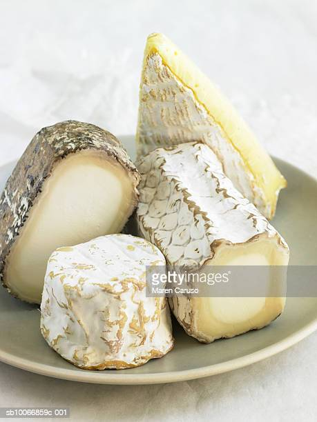 Soft ripened cheeses on plate