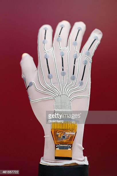A soft stretch glove with Yamaha Corp's rubberlike stretchable strain sensor sits on display at the Wearable Expo in Tokyo Japan on Thursday Jan 15...