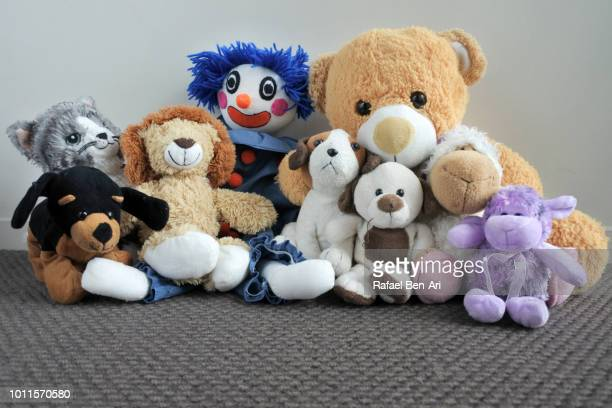 soft toys collection - happy clown faces stock photos and pictures