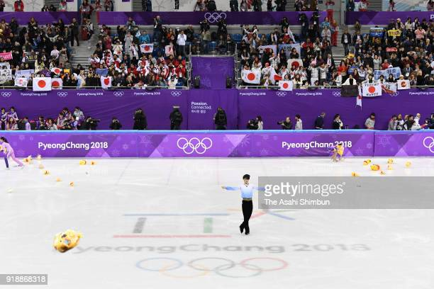Soft toys of Winnie the Pooh are thrown by fans as Yuzuru Hanyu of Japan applauds fans after competing in the Men's Single Skating Short Program on...