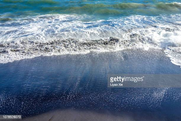 soft wave on the sandy beach - liyao xie stock pictures, royalty-free photos & images