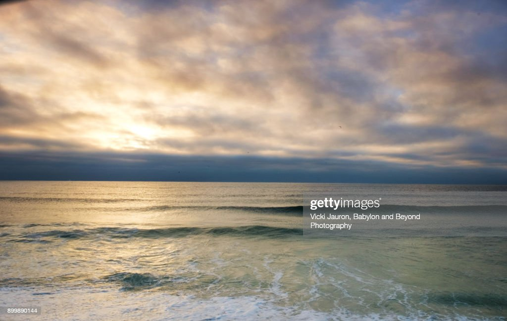 Soft Waves And Clouds At Sunrise Jones Beach Long Island Stock Photo