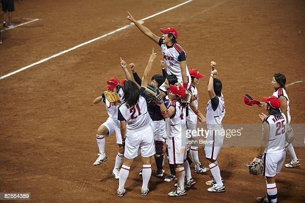 2008 Summer Olympics Japan Yukiko Ueno victorious getting carried by team after winning Women's Grand Final gold medal vs USA at Fengtai Softball...