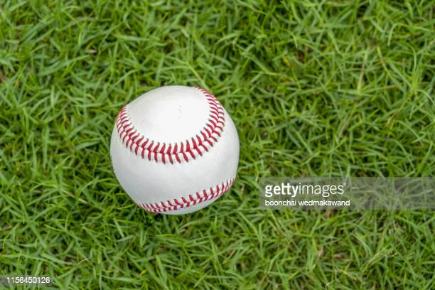 softball ball on the lawn - base sports equipment stock pictures, royalty-free photos & images