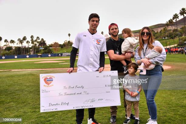 California Strong Celebrity Game Milwaukee Brewers Christian Yelich presenting check to The Reid Family after game at Pepperdine University The...