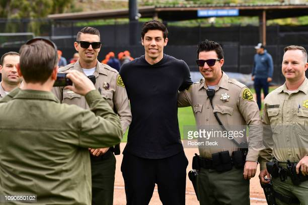 California Strong Celebrity Game Milwaukee Brewers Christian Yelich posing for pictures with Los Angeles Sheriffs before game at Pepperdine...