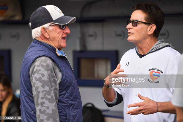 California Strong Celebrity Game Milwaukee Brewers play by play announcer Bob Uecker with actor Charlie Sheen in dugout during game at Pepperdine...