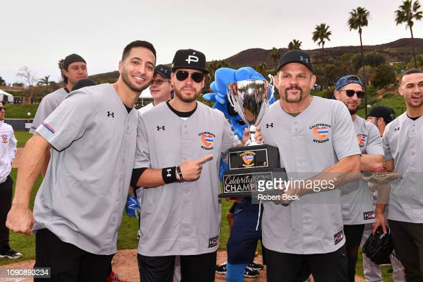 California Strong Celebrity Game Milwaukee Brewers Ryan Braun and MMA fighter Chuck Liddell holding trophy after game at Pepperdine University Malibu...