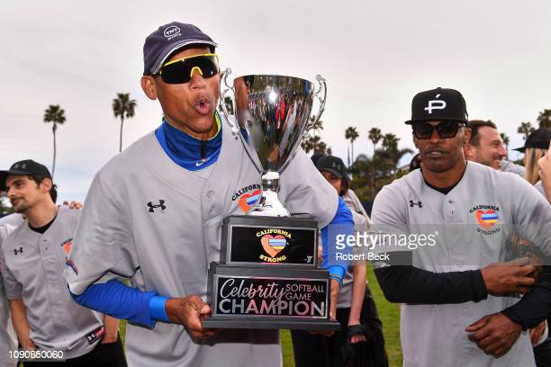 California Strong Celebrity Game NBA Hall of famer Reggie Miller victorious holding trophy after game at Pepperdine University The charity game...