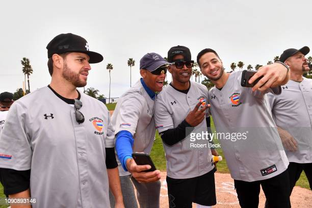 California Strong Celebrity Game NBA Hall of Famer Reggie Miller comedian Jamie Foxx and Milwaukee Brewers Ryan Braun taking a selfie after game at...