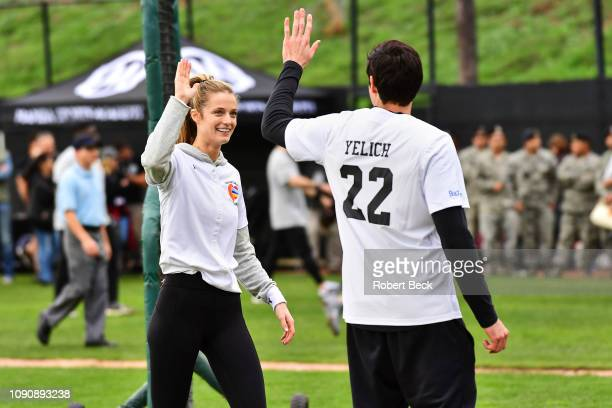 California Strong Celebrity Game Sports Illustrated swimsuit model Kate Bock victorious giving high five with Milwaukee Brewers Christian Yelich...