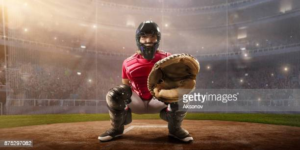 softball female catcher on a professional arena - baseball catcher stock photos and pictures