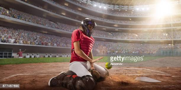 Softball female catcher on a professional arena