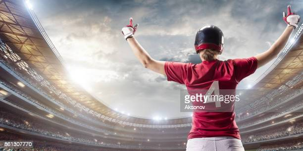 softball female player happy after the victory on a professional arena - baseball uniform stock pictures, royalty-free photos & images